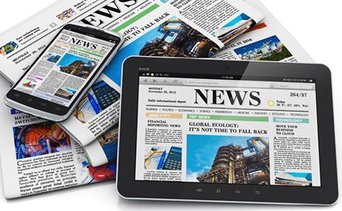 jornal, tablet e smartphone